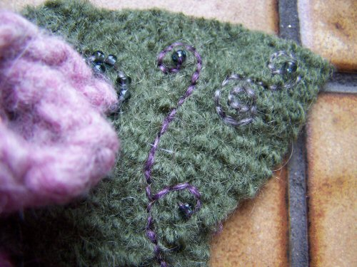 felted-brooch-detail-of-bead-and-stitching.jpg